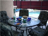 Covered lanai for enjoying meals by the pool