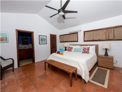 Master bedroom with king size bed and AC