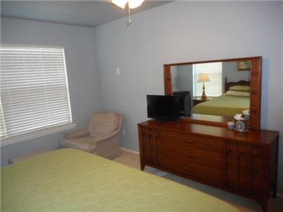 Master bedroom king size bed and TV