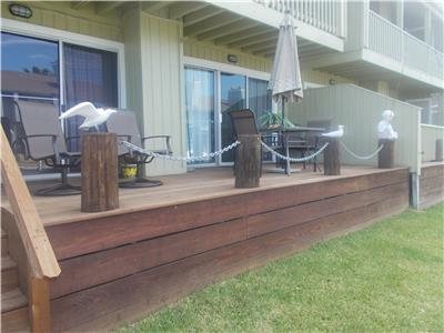 Canal side deck with table, chairs & umbrella