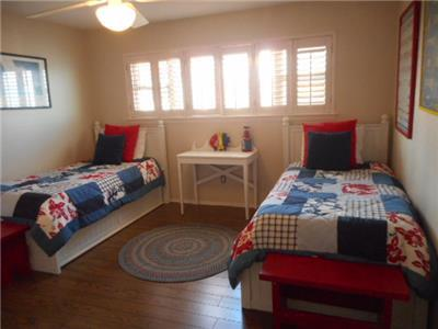 Guest bedroom upstairs with two twin beds
