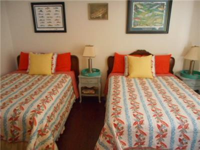 2 Double beds in guest bedroom