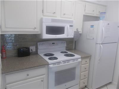 Full sized appliances in kitchen