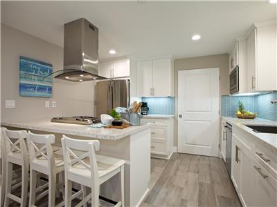 Lower: Fully equipped gourmet kitchen