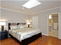 2 BR - Master bedroom with King bed and TV