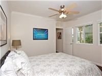 1 BR unit: Bedroom with queen bed and TV