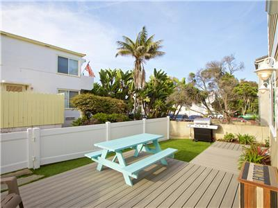 Furnished patio with BBQ with partial ocean views