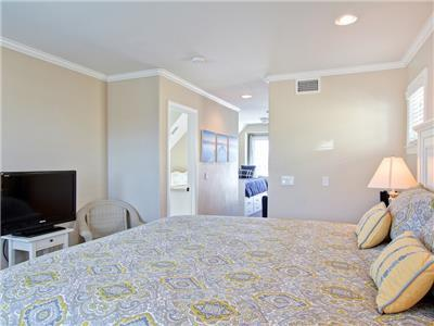 Master bedroom offers additional sleeping and TV