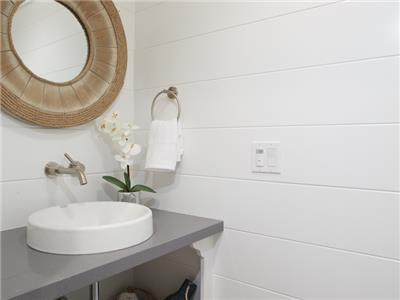 Upper: bathroom by living area