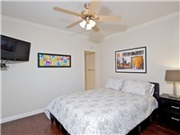 1 BR - Bedroom with queen bed and TV