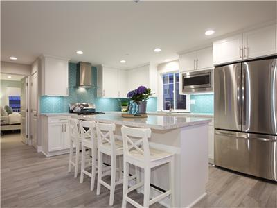 Upper: Fully equipped gourmet kitchen