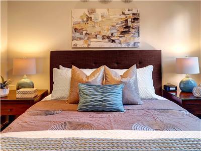 Queen sized bed in second bedroom.