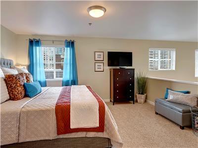 Master suite is open to living area below.