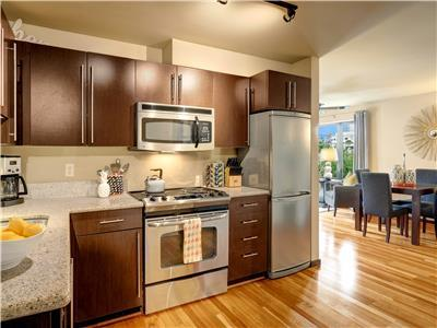 Kitchen is open to living area.