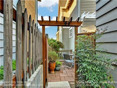 Continue through second arbor to private patio