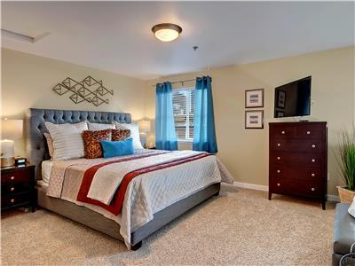 Master bedroom is roomy and stylish.