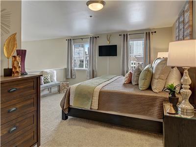 Master suite is open to living room below.