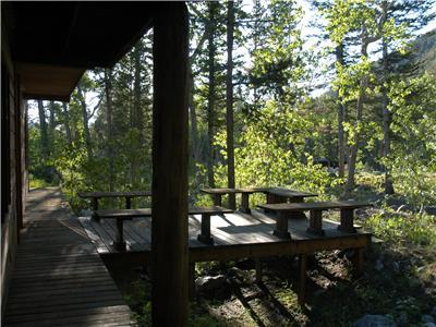 Lower deck, next to the creek.