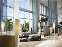 Lobby features high ceilings and sophisticated furnishings