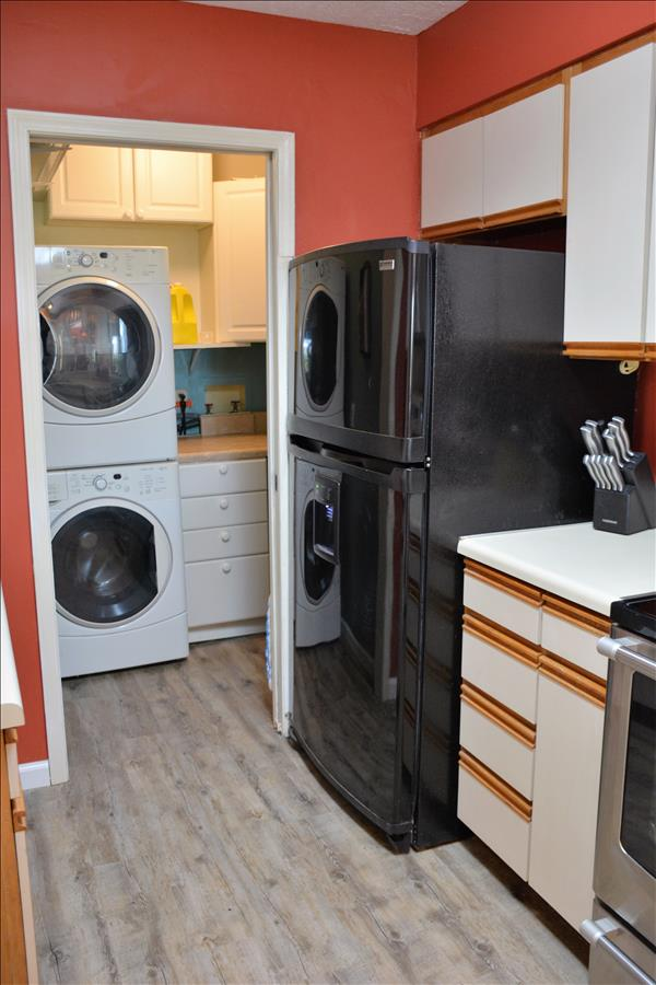 Laundry room w/stackable washer and dryer.