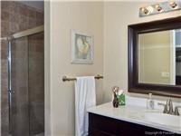 Travertine and glass shower