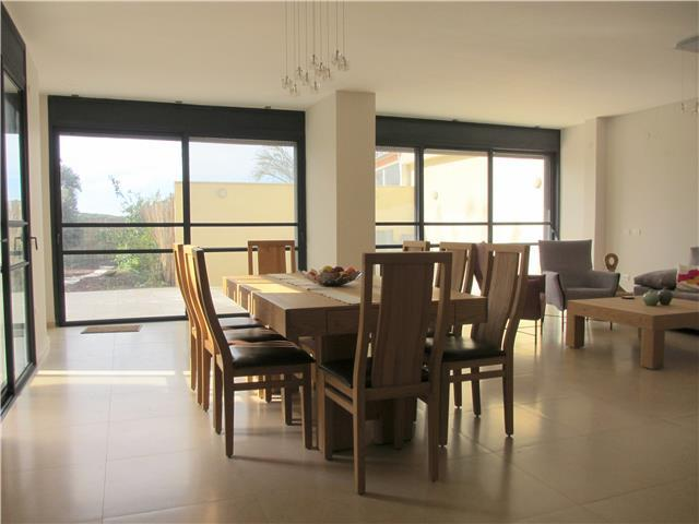 Large open plan living area leading to garden