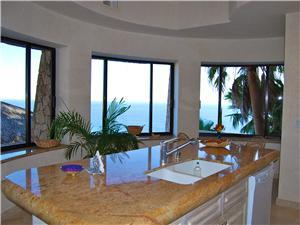 The kitchen has ocean views