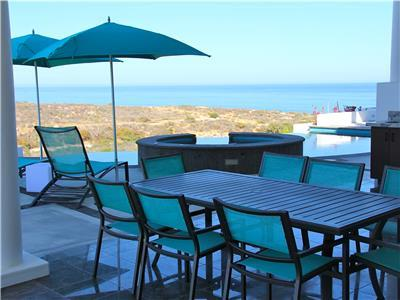 Outdoor dining set on the pool deck