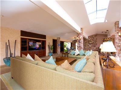 Large living room with wide screen TV