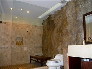 The 3rd suite bathroom is built into the hillside