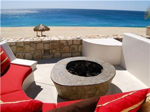 Beach side fire pit with sofa seating