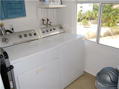 There's a laundry room with wash out sink in condo