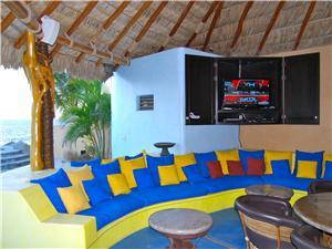 There is an out door palapa with satellite TV