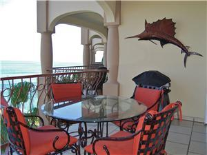 Terrace in front of dining room has a dining set