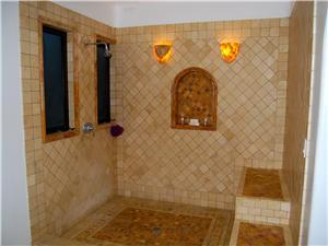 Private shower with custome tile and rock work