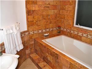 Upstairs bathroom even has a bathtub