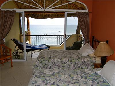 This guest bedroom has an ocean view