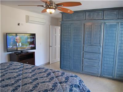 Guest bedroom has large closets and satellite tv