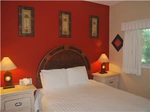 Guest bedroom has a Queen size bed