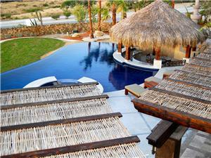 Infinity pool with a swim up palapa bar
