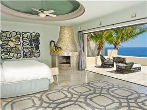 Master bedroom with fireplace and ocean view s