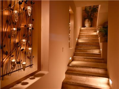 The stairs to the upper level master bedrooms