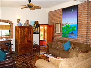 Second level living room has satellite TV