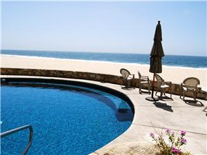 The pool sits right on the beach