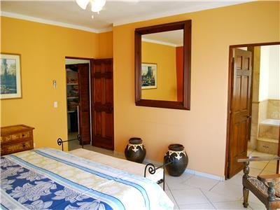 The master bedroom has a private bathroom