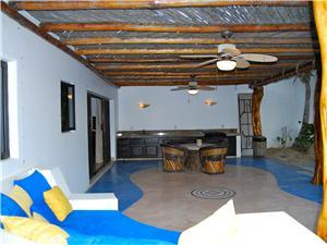 The second casita has a couch and dining area