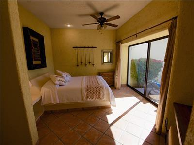 The master bedroom opens to the pool patio