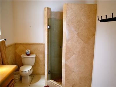 The shared bathroom has a shower