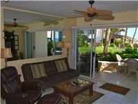 The Living Room opens up to the pool and beach