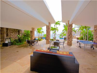 Lounge area in front of pool